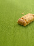 Apple strudel crispy pies on green tablecloth background. Stock Image