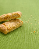 Apple strudel crispy pies on green tablecloth background Stock Images