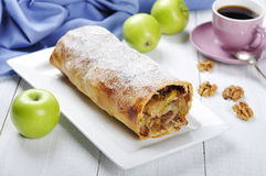 Apple strudel. On a dish with fresh apples and cup of coffee Stock Photography