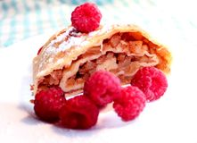 Apple strudel and fresh raspberries royalty free stock images