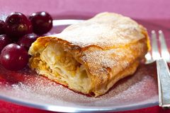 Apple strudel with hot cherries Royalty Free Stock Photos