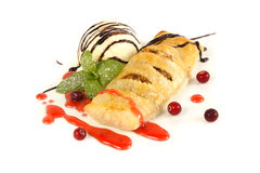 Apple strudel with ice cream. And berries Stock Photography