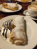 Apple strudel with ice-cream, chocolate topping and sugar powder royalty free stock image