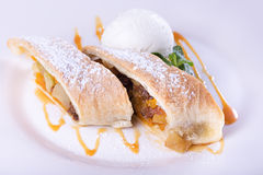 Apple strudel with ice cream Royalty Free Stock Photos