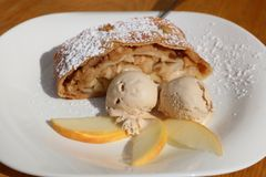 Apple Strudel with Ice Cream on Plate Royalty Free Stock Images