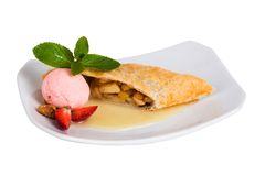 Apple strudel with ice cream strawberries and mint Royalty Free Stock Photo
