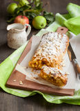 Apple strudel. With icing sugar and almond Stock Photos