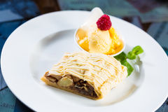 Apple strudel with icing sugar,almonds and vanilla Royalty Free Stock Photography