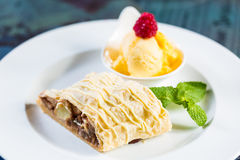 Apple strudel with icing sugar,almonds and vanilla Stock Photos