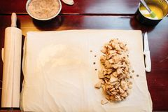 Apple strudel ingredients, top view, nobody. Apple strudel ingredients on wooden kitchen table, top view, nobody. Homemade sweet dessert, pastry preparation Stock Photos