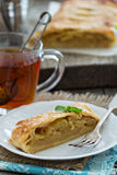 Apple strudel with tea Stock Photography