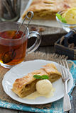 Apple strudel with tea Royalty Free Stock Image