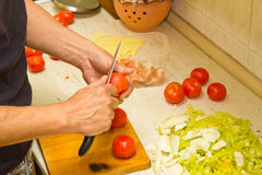 Male hands preparing vegetable dish Stock Photo