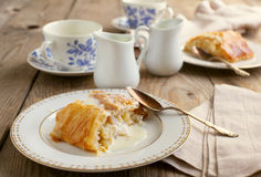 Apple strudel with vanilla cream sause. Selective focus Stock Photography