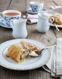 Apple strudel with vanilla cream sause. Selective focus Royalty Free Stock Images
