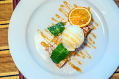 Apple strudel with vanilla ice cream Royalty Free Stock Image