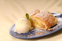 Apple strudel with vanilla ice cream and mint stock image