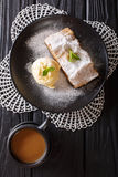 Apple strudel with vanilla ice cream on a plate and coffee with Royalty Free Stock Photo