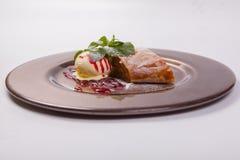 Apple strudel with vanilla ice cream Royalty Free Stock Photography