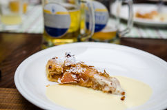Apple strudel with vanilla sauce Stock Photos