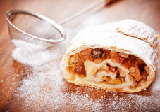 Apple strudel on a wooden board Stock Image