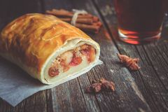 Apple strudel on wooden board served with tea royalty free stock photo