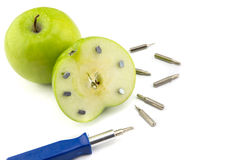 Apple stuck with nails, detail of a fruit with iron, tool. Abstract, healthy food, fruit Royalty Free Stock Photography