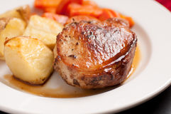 Apple stuffed pork chop. Pork chop stuffed with apple with potatoes and carrots royalty free stock photos