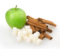 Apple, sugar cubes, cinnamon Stock Photography