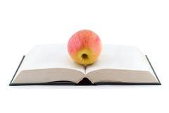 Apple sur le livre Photo stock