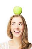 Apple sur sa tête Photos stock