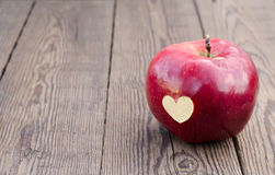 Apple with a symbol heart Royalty Free Stock Images