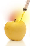 Apple and syringe Royalty Free Stock Photos
