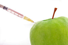 apple with   syringe Stock Photos