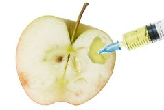 Apple and syringe. Genetic modification food Stock Photos