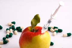 Apple or syringe? Royalty Free Stock Images