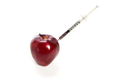 Apple and syringe Royalty Free Stock Photography