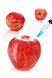 Apple and syringe Stock Image