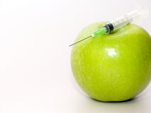Apple with syringe Royalty Free Stock Photos