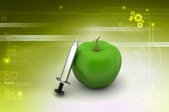Apple  with syringe Royalty Free Stock Photo