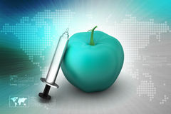 Apple  with syringe Royalty Free Stock Image