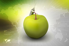 Apple  with syringe Royalty Free Stock Photography