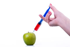 Apple with syringe Royalty Free Stock Images