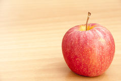 Apple on table Royalty Free Stock Image