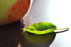 Apple on the table Royalty Free Stock Photos
