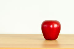 Apple On The Table. Red Apple On The Wood Table, White Background For Kitchen Decoration Royalty Free Stock Image