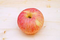 Apple on the Table Wood. One red Apple on the Table Wood Royalty Free Stock Image
