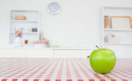 An apple on a tablecloth Stock Photo