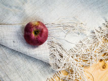 Apple on the tablecloth Royalty Free Stock Image