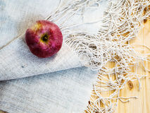 Apple on the tablecloth Royalty Free Stock Images
